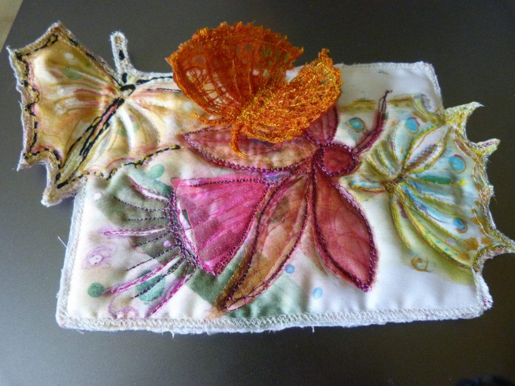 Robina front of postcard butterflies