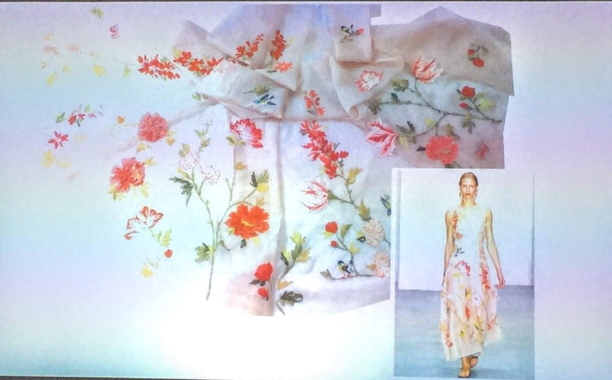 white dress with orange flowers